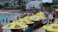 Sint Maarten 093 Maho Beach people run in water because of thrust of aircraft - stock footage