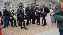 Fetishism - group of men in a leather suits posing during gay pride Stock Footage
