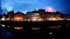 Scenic fireworks at night over old town Nyhavn, Denmark, Copenhagen Stock Footage
