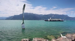 Giant steel fork in water of Geneva lake, Vevey, Switzerland Stock Footage