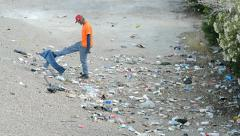 Unknown man looking for wasted things near Las Vegas Strip, Las Vegas, USA. Stock Footage