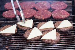 hot grill burger cutlet barbeque on grating - stock photo