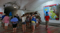 Tourists look museum exposition on the old Soviet submarine base. Stock Footage