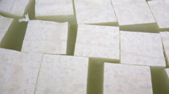 Feta cheese production cubes - stock footage