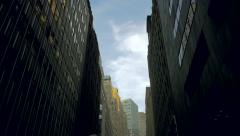 Towering NYC skyscrapers against blue sky, low angle view - stock footage