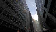 Low angle panning on NYC skyscrapers ending with Financial District street - stock footage