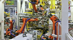 Robots in a car factory Stock Footage