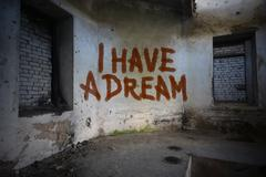 text i have a dream on the dirty old wall in an abandoned ruined house - stock photo