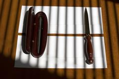 Biro pen and sharp paper knife Stock Photos