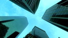 Towering corporate buildings in New York City against blue sky, low angle - stock footage