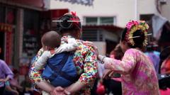 Xunpu female chatting in village Stock Footage