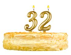 Stock Photo of birthday cake with candles number thirty two