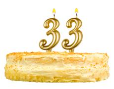 birthday cake with candles number thirty three - stock photo