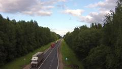 Highway with trucks aerial quadcopter drone flight Stock Footage