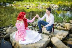 Fairy Tale Couple by a River Looking Dreamy at Each Other Stock Photos
