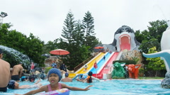 People playing in summer player in water park - stock footage