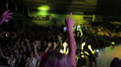 Blonde female DJ jumping with the crowd Stock Footage