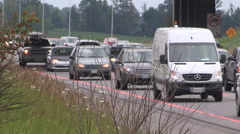 Stock Video Footage of Heavy traffic on highway 400 north of Toronto on hot summer day