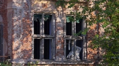 Broken windows on old abandoned house Stock Footage