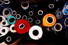 abstract stack of fabric roll in the factory - stock photo