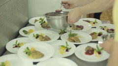 Chef prepares foie gras to feed on catering Stock Footage