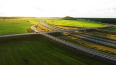 Highway trough green fields. Aerial footage - stock footage