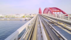 Pov real-time ride through Kobe Japan on the monorail Stock Footage
