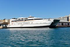 VALLETTA, MALTA - APRIL 22: The speed ferry is going to Sicily, Italy on Apri Stock Photos