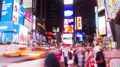 Many people in Times Square at night, time lapse Stock Footage