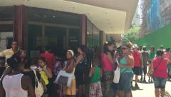 Cuban waiting in line for the public Cinema in Havana, Cuba. - stock footage