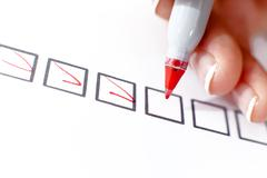 Woman marking in a checkbox - stock photo