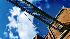 Metal gangway against blue cloudy sky Stock Illustration