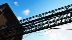 Metal bridge against blue cloudy sky Stock Illustration