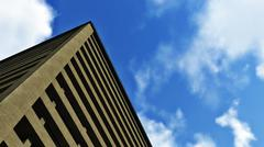 Look up multistory building against blue sky - stock photo