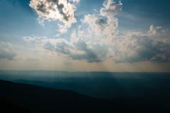 Crepuscular rays over the Shenandoah Valley, seen from Little Stony Man Cliff - stock photo