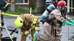 Hazmat team decontamination washing process Stock Footage