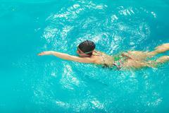 Woman athlete swimming crawl stroke in pool. - stock photo