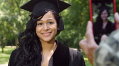 A  Graduate being photographed with a smartphone - stock footage
