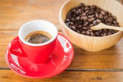 Fresh brewed hot espresso with roasted bean Stock Photos