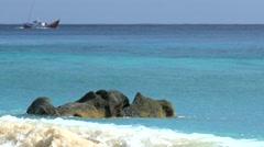 Turquoise sea with defocused fisherman boat sailing on horizon Stock Footage