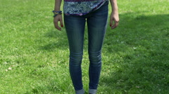 Stock Video Footage of Skinny girl standing in the park and looking somwhere