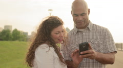Happy couple using a smart phone in Detroit 4K - stock footage