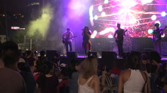 Rock concert crowds and stage lighting Stock Footage
