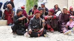 Tibetan buddhist old people in Lamayuru Gompa, Ladakh, India Stock Footage