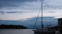 Sailing Boat in Harbor at Dusk Stock Footage
