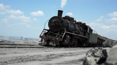 steam locomotive stops on a mine residue hill - stock footage