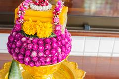 Globe Amaranth and marigold flower and candle decorating on golden tray Stock Photos