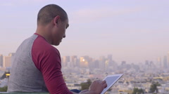 Tourist Uses Tablet To Photograph San Francisco Skyline (4K) Stock Footage