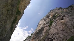 Steep canyon with sky and clouds hurried-timelapse Stock Footage