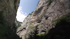 Steep canyon with sky and clouds-panoramic view Stock Footage